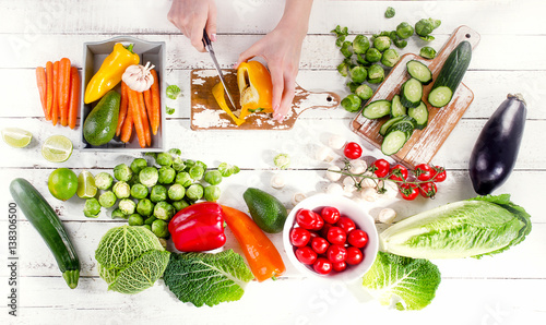 Woman hands with fresh raw vegetables.
