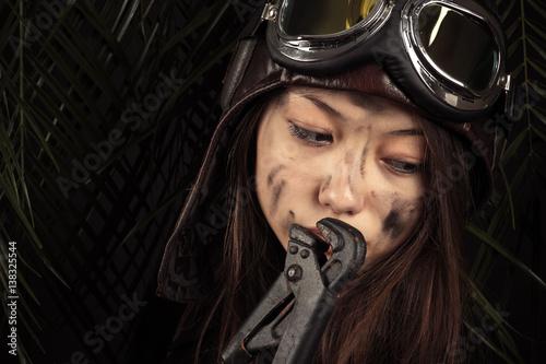 attractive pensive girl mechanic in the aviation helmet