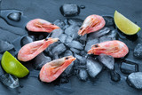 Shrimp with lime on a black background