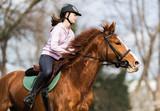 Young girl riding a horse - 138355943