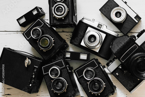 Poster vintage backgroun with collection old retro photo cameras