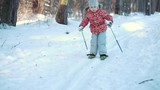 A little girl is learning cross country skiing