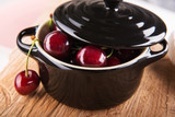 Juicy cherries in black vessel