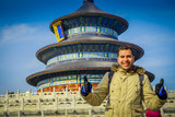 BEIJING, CHINA - 29 JANUARY, 2017: Temple of heaven, imperial complex with spectacular religious buildings located at southeastern central city area, tourist posing happily, beautiful circular ancient