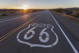 Route 66 highway sign sunset in the California Mojave Desert.