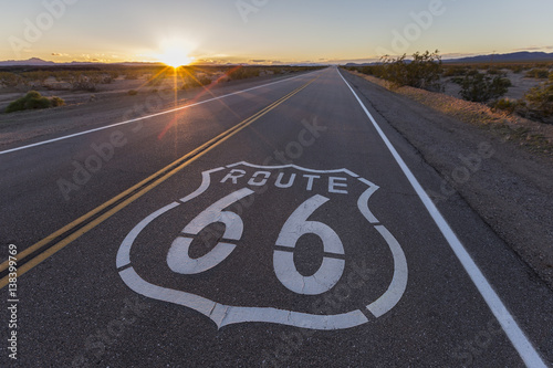 Spoed canvasdoek 2cm dik Route 66 Route 66 highway sign sunset in the California Mojave Desert.