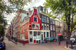 Amsterdam street with typical dutch houses in Holland, Netherlands.