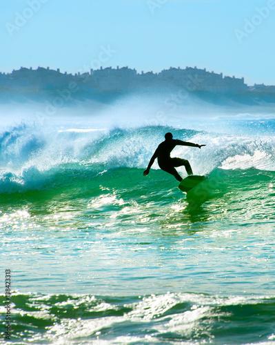 Surfer on a wave - 138423313