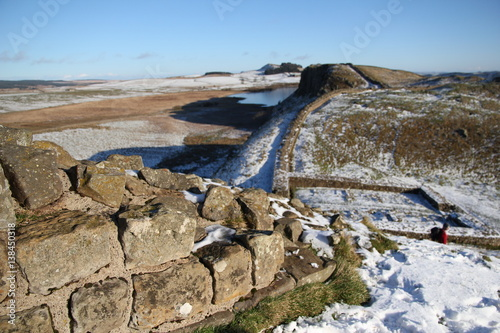 Poster The foreground of the image shows Hadrian's wall in focus highlighting the struc