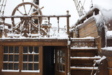 Elements of the old sailing ship in the snow