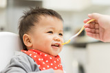 Asian baby boy eating blend food on a high chair - 138486155