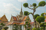 Decorative gardens and front gate to Wat Arun Temple in Bankgkok, Thailand
