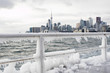 Skyline of Toronto during winter season with ice in Lake Ontario