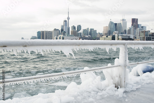 Fotobehang Toronto Skyline of Toronto during winter season with ice in Lake Ontario