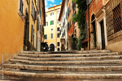 Staande foto Rome Roman street in the morning with stairs leading to the fountain