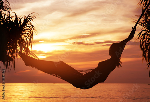 Foto op Plexiglas Artist KB Portrait of a young, attractive woman watching a sunset
