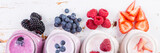 Fototapety Selection of colorful detox berry drinks on wood background