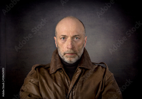 headshot of man in leather jacket Poster