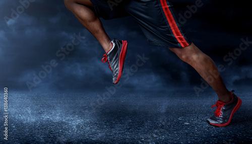 Man running on asphalt road - 138640360
