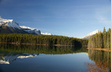 Reflections of mountain and forest in lake,Columbia Icefield Parkway, Alberta, Canada