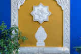 Decorated wall in Islamic style with yellow and blue in le Jardin Majorelle garden (Yves Saint Laurent) in Marrakesh - Morocco