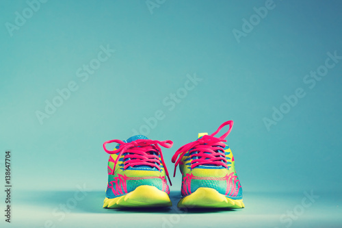 Juliste Colorful running sneakers on a blue background