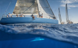 Blue sailing boat on the sea with keel under water - 138662368