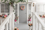 White small wooden house with gray door. spring flower decoration - 138676900