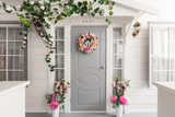 White small wooden house with gray door. spring flower decoration - 138676918