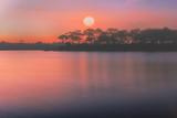 Sunrise or sunset over the lake.