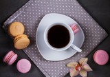 Coffee and cake macaron or macaroon on gray background from above. Flat lay, top view