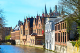 cityscape with houses, bridge and Green canal, Groenerei in Bruges, Belgium