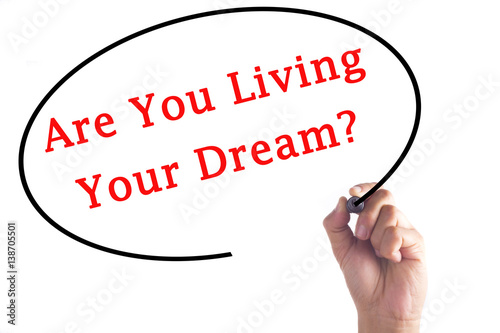 Hand writing Are You Living Your Dream? on transparent board Poster