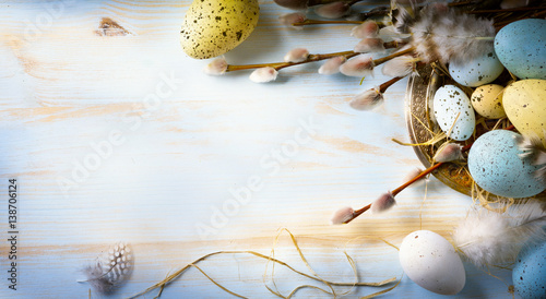 Easter background with Easter eggs and spring flowers. Top view with copy space - 138706124