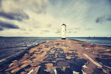 Color toned picture of old lighthouse in Swinoujscie, Poland