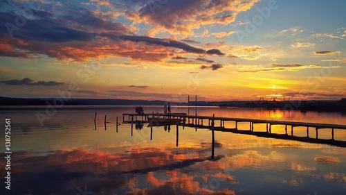 Foto op Aluminium Pier Golden sunset over the lake