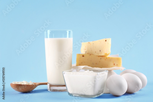Foto op Aluminium Kruiden 2 Different dairy products on color background