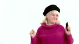 Happy elderly woman with phone. Lady smiling and jumping. Burst with happiness.