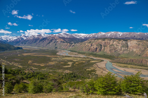 Beautiful landscape view on the river valley with snow crapped mountains, Patagonia.