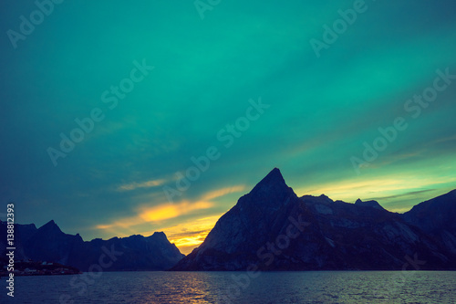 Poster Fjord at sunset, Rocky beach in evening