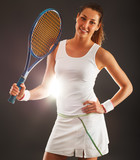 Female tennis player in sports outfit holding a racket.