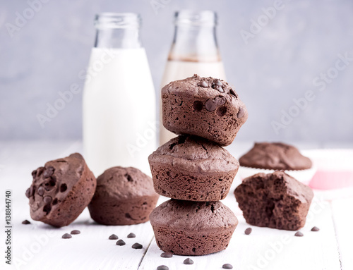Poster Chocolate muffin with two bottle of milk Chocolate milk Wooden background