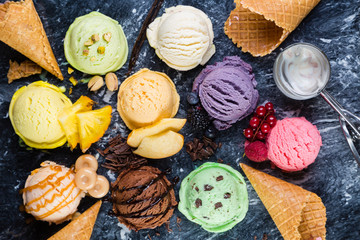 Selection of colorful ice cream scoops on marble background