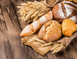 Leinwanddruck Bild - assortment of baked bread on wood table