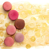 Macarons on bright yellow texture with copyspace