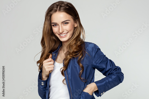 Beauty portrait of smiling female face with natural skin