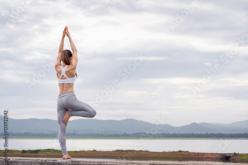 Poster Asia woman doing yoga fitness exercise