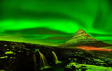 View of the northern light over Kirkjufell Mountain in Iceland.