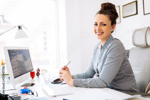 Accountant working in her office © nd3000