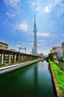 View of the railway and Tokyo Skytree from a river in a sunny day in Tokyo